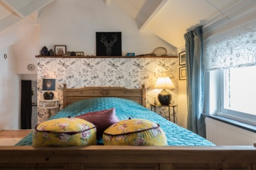 De blauwe slaapkamer